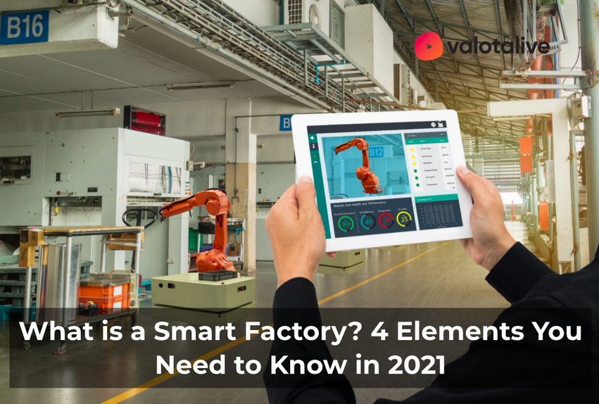 A person holding a tablet in a factory facility